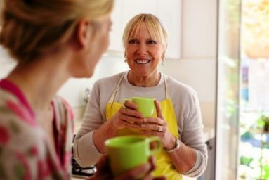 Stock Photo of Two People Drinking Tea in a Kitchen