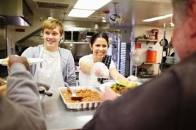Stock Photo of Two People Serving Food
