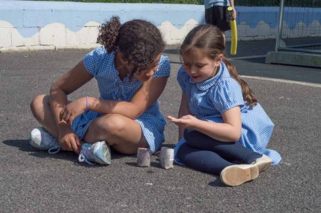 Children counting marbles